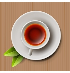 Cup of black tea top view on cardboard vector image