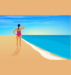 a young woman is standing on seashore vector image