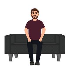 A man sits on a sofa a bearded smiling man waits vector