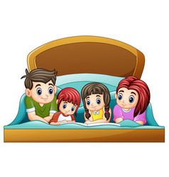 Family reading a book to two daughter on bed on a vector