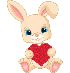 Rabbit holds love heart vector image