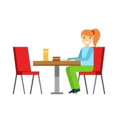 Girl Sitting At The Table Eating A Cake Smiling vector image