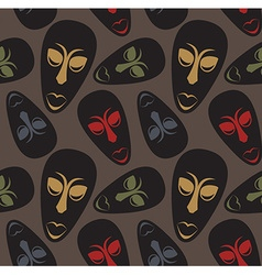 Seamless pattern with african masks vector