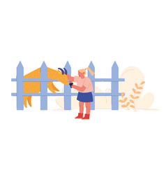 Cheerful kid feeding cute goat in wooden cage vector