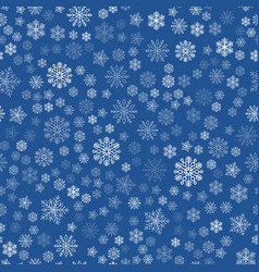 seamless texture of white snowflakes on a blue vector image vector image