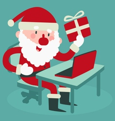 Cute Santa Holding a Gift At the Computer vector image
