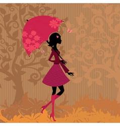 woman under an umbrella in the autumn vector image