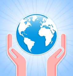 Caring hands with planet Earth vector image