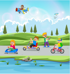 children are playing and riding bicycle vector image