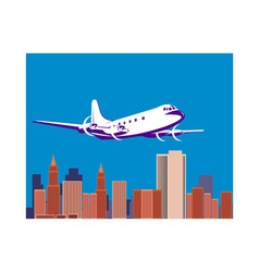 propeller airplane taking off with buildings vector image vector image