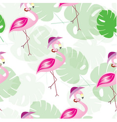 Seamless pattern with flamingos and tropical leaf vector