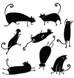Silhouettes of cute cats vector