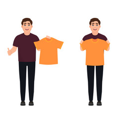 The guy holds an orange t-shirt a cheerful man vector