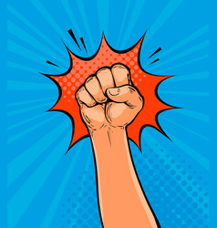 raised up clenched fist drawn in pop art retro vector image