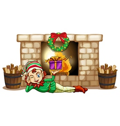 An elf in front of the fireplace vector image