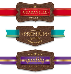 Leather quality labels with ribbon vector image