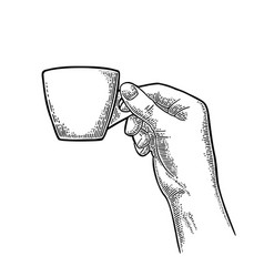 hand holding a cup of coffee vintage black vector image