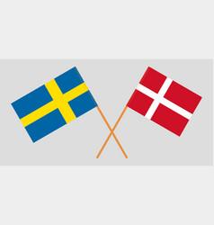 Crossed swedish and danish flags vector