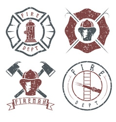 grunge set of fire department emblems and badges vector image