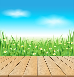 Wooden table on spring meadow vector image