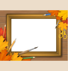 picture frame with autumn leaves and art supplies vector image