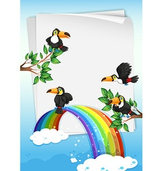 Paper design with toucans flying in sky vector