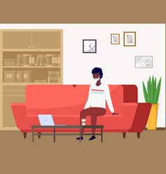 young man in mask sitting on sofa at small vector image