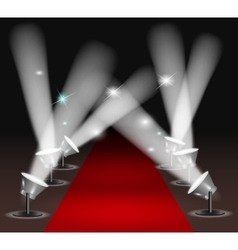 Red carpet with spotlights vector image