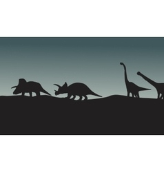 Silhouette of triceratops and brachiosaurus vector image vector image