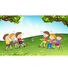 Boys and girls playing tug of war vector