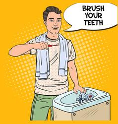 pop art smiling man brushing teeth in bathroom vector image vector image