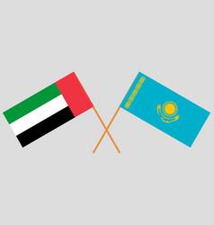 Crossed flags kazakhstan and united arab vector