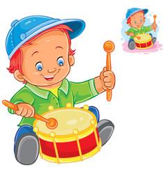 Little boy beat the drum vector