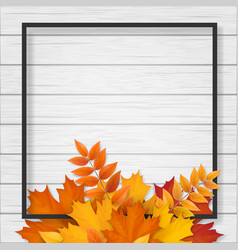 frame with autumn leaves on wooden background vector image