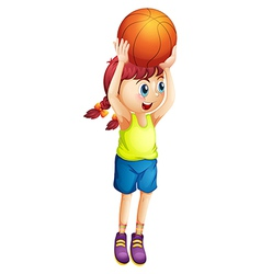 A young female basketball player vector image