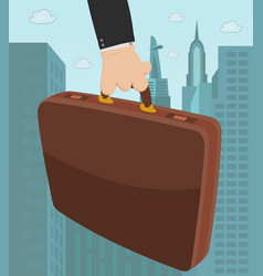 briefcase in a hand vector image