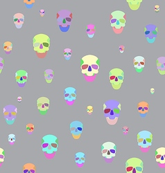 Seamless with motley skulls vector