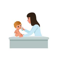 Female pediatrician in white coat doing inhalation vector
