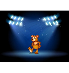 A stage with a bear dancing at the center vector image