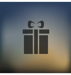 Gift box icon on blurred background vector
