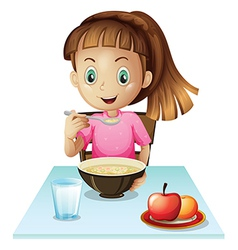 A girl eating breakfast vector image