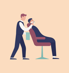 barber putting foam and shaving young man sitting vector image