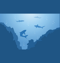 Silhouette of shark and cliff on blue sea vector