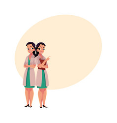 two woman doctors in medical coats standng vector image vector image