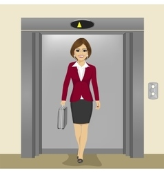 businesswoman coming out of office elevator vector image