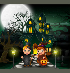 Couple witch in front of the hounted house with fu vector