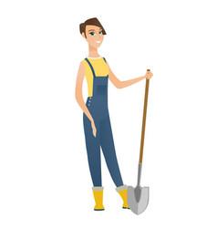 Young caucasian farmer holding a shovel vector