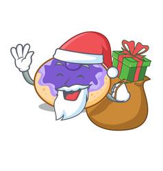 Santa with gift donut blueberry mascot cartoon vector
