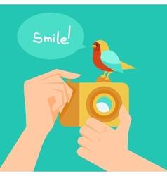 digital camera and cartoon bird vector image vector image