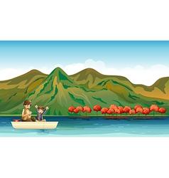 Two boys fishing vector image